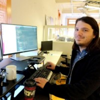 Matthew with coffee and code